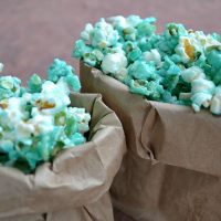 closeup of blue candied pocorn in small paper bags