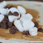 Closeup of torilla with peanut butter mini marshmallows and chocolate chips