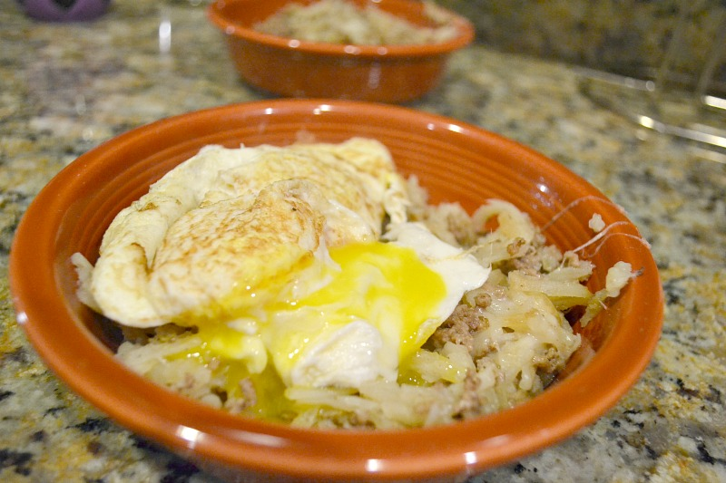 red bowl with hanburger hash with egg on top