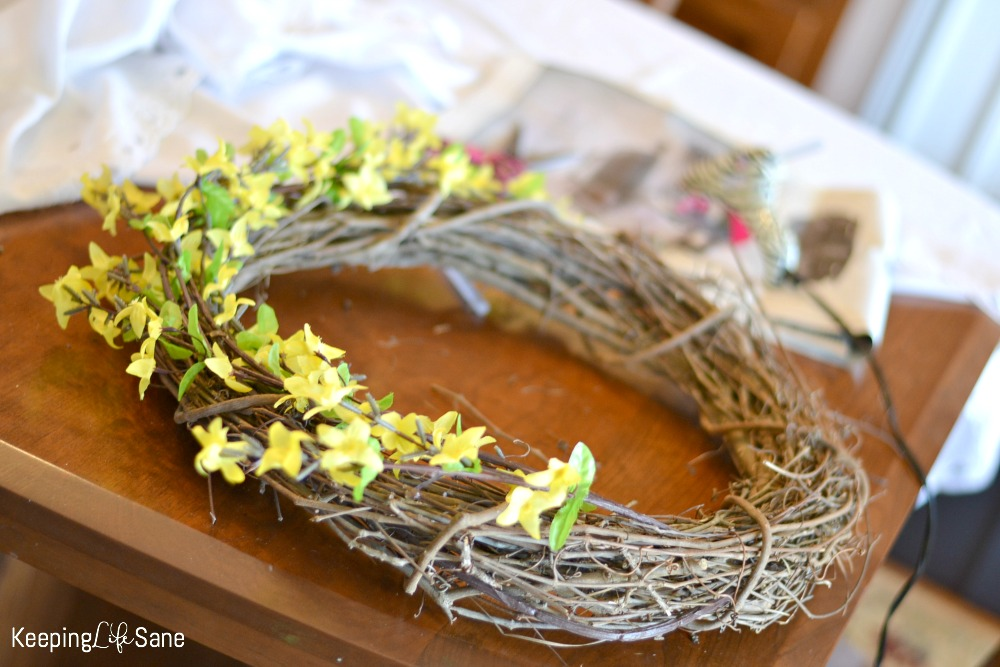 Here's an easy DIY spring wreath for people who aren't crafty! It only takes a few steps to have a great looking door. It's inexpensive too, under $20!
