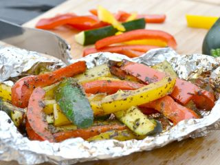 zucchini and peppers on foil that have been grilled