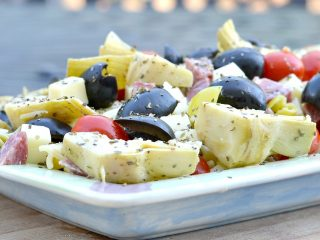 antipasto withrotini, grape tomatoes, olives, cheese cubes, artichokes, salami and cheese cubes