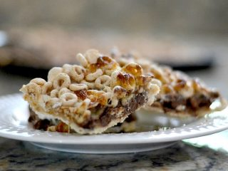 cheerio cereal bars on white plate sitting on kitchen counter
