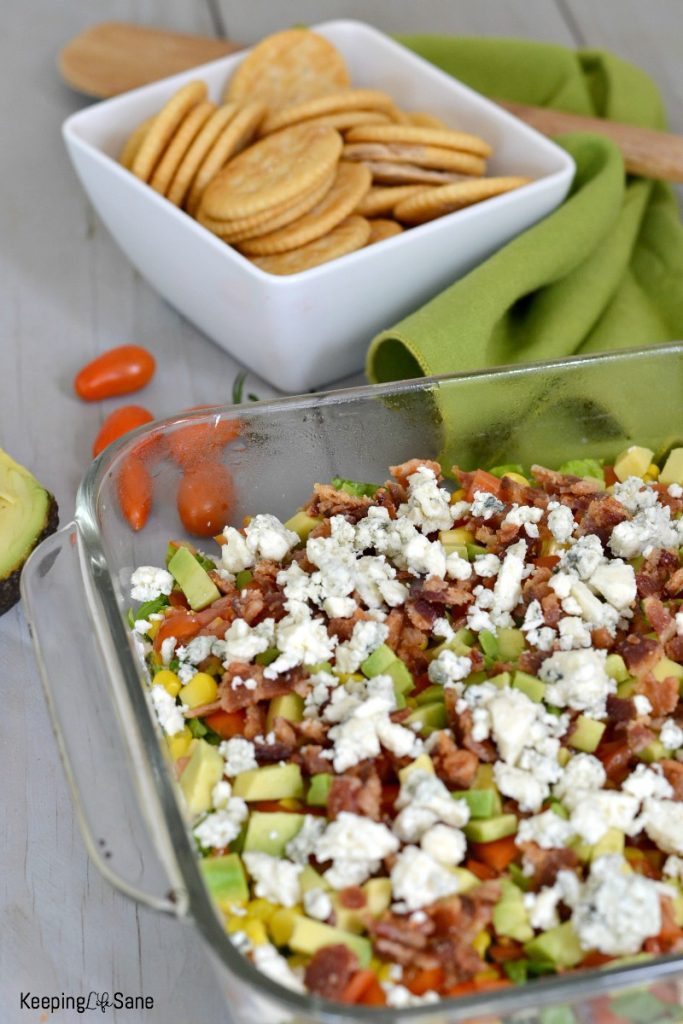 This recipe for COBB DIP is perfect for anytime of year- football tailgating, summer picnic, or New Year's Eve! Everyone loves it!