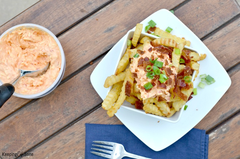 Who doesn't love cheese fries? You are going to love this version of pimento southern cheese fries. Great for an appetizer to share or a yummy snack.