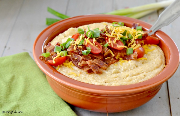 cheese grits with bacon, tomatoes, shredded yellow cheese and green onions
