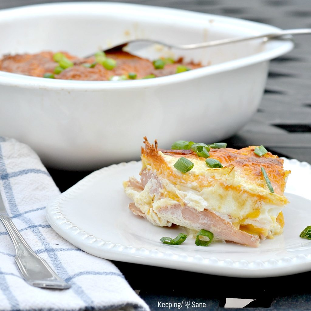 This dinner recipe for ham and cheese potato bake is AWESOME! It's quick and easy! Perfect for a busy weeknight. It's a family favorite.