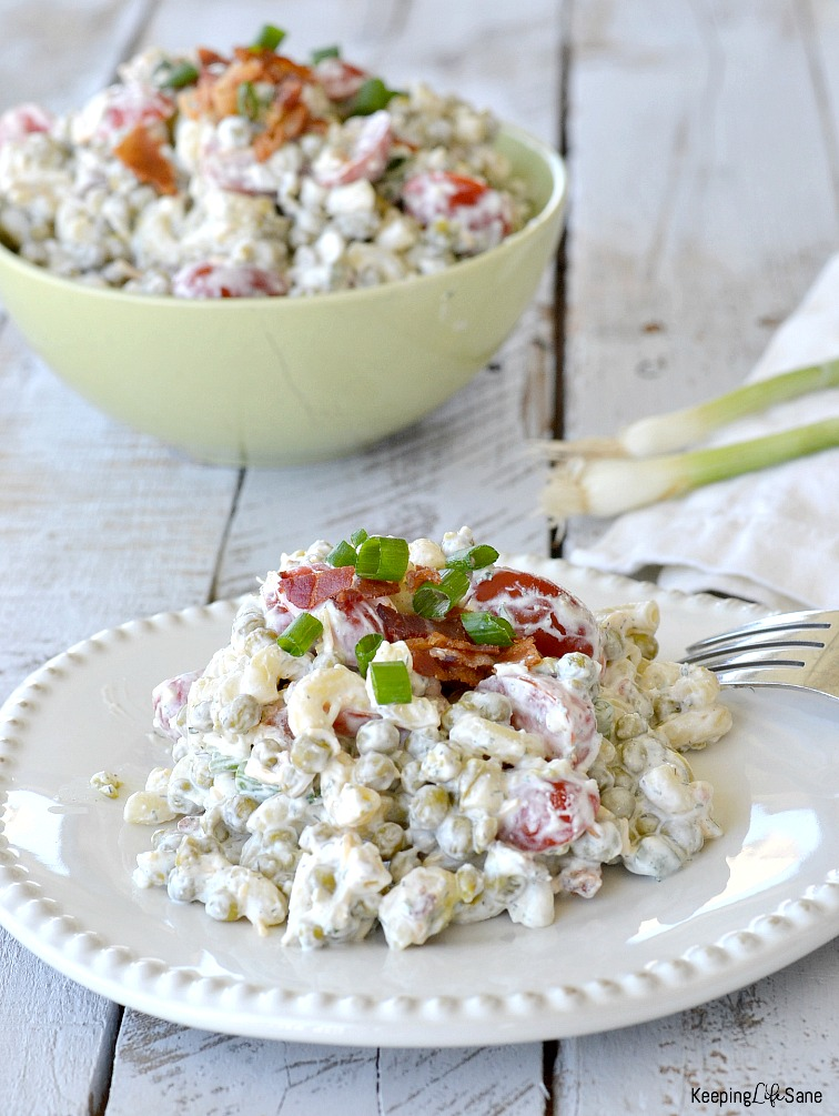 Creamy pea salad with bacon is the perfect side to any lunch or dinner AND easy dish for your next potluck. It's a painless way to get your kids to eat those veggies!