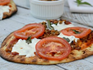 ground chicken on pizza with Mozzarella, basil leaves and tomato slices