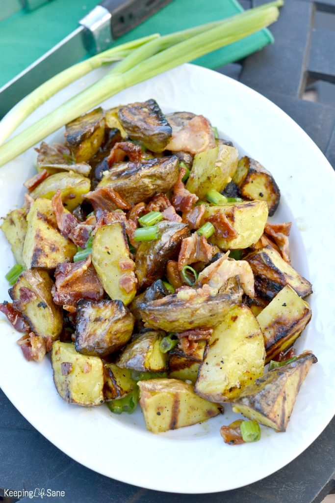 Grab this grilled potato salad with bacon vinaigrette recipe. It's perfect for a summer cookout or potluck gathering. Who doesn't love anything with bacon?