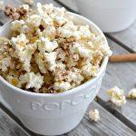 white popcorn bowl with cinnamon popcorn overflowing