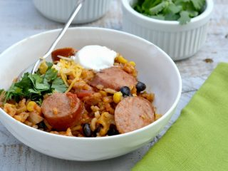 Mexican sausage recipe in white bowl with green napkin