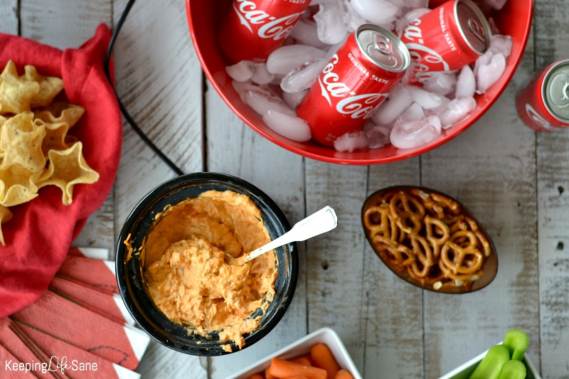 My family LOVES this EASY slow cooker buffalo chicken dip. It's perfect for the tailgating party you're having this weekend.