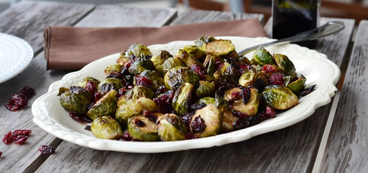 White bowl with Brussels sprouts and craisins