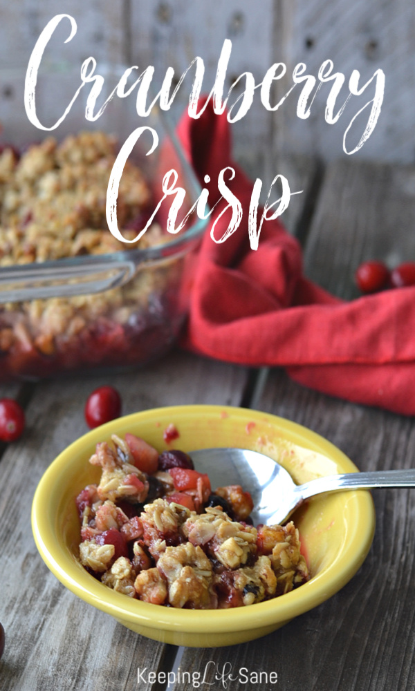 You are going to die for this baked cranberry crisp. It's perfect for fall and the holidays. #Cranberries #Fall #Autumn #Holiday #Thanksgiving #ThanksgivingMenu #Thanksgivingdessert #Christmas #ChristmasMenu #PartyFood #Baked #Homemade #CranberryCrisp