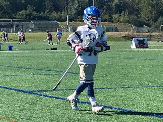 lacrosse player running out onto the field