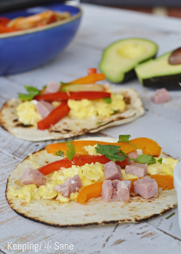 Are you looking for a new breakfast idea? These easy breakfast fajitas are delicious and everyone loves them. They're perfect for a crowd. #Breakfast #BreakfastRecipe #BreakfastFajitas #BreakfastIdea #EasyBreakfast #HealthyBreakfast #Recipe #Fajitas #Ham #Peppers #Cilantro