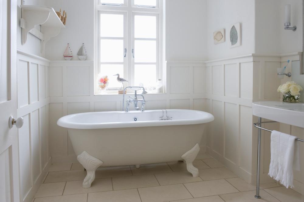 white bathroom with big white claw bathtub