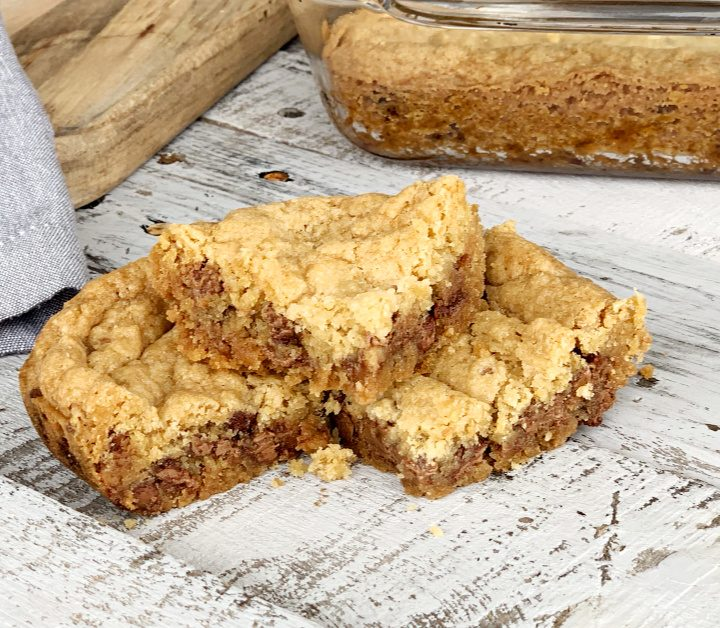 These eggless chocolate chip cookie bars are a family favorite. This easy dessert won't last long. Who doesn't like soft and chewy cookie bars?
