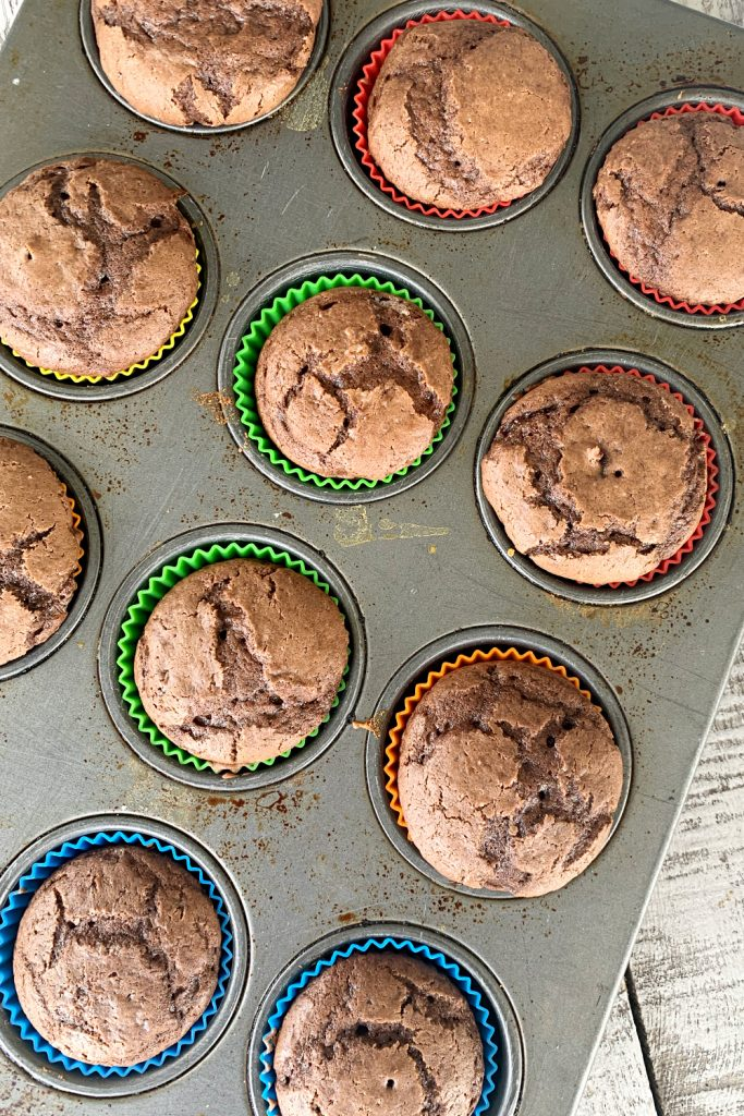 Chocolate cupcakes in a muffin tin