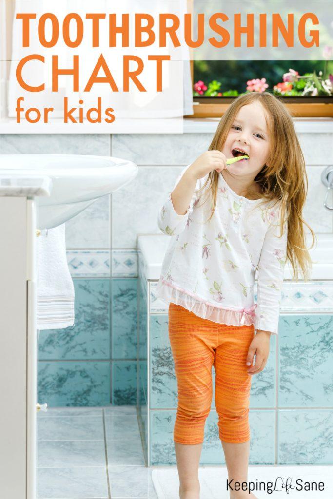 little girl with long hair in orange pants brushing teeth in a bathroom