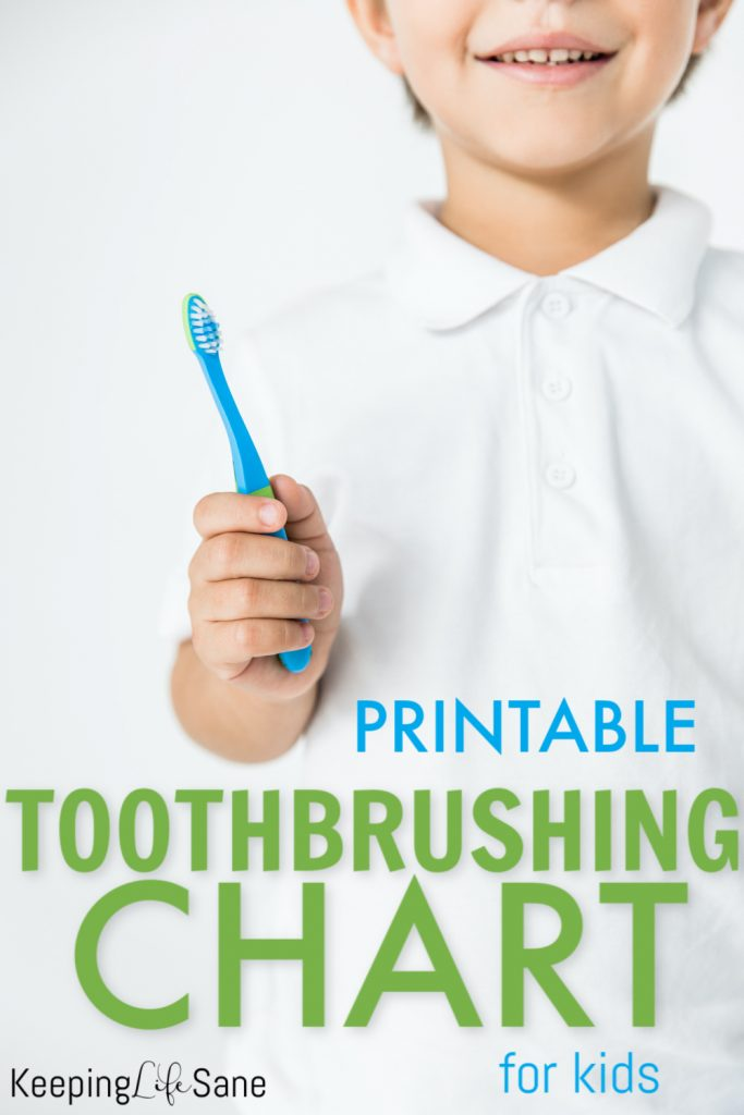Boy in white shirt holding a blue toothbrush