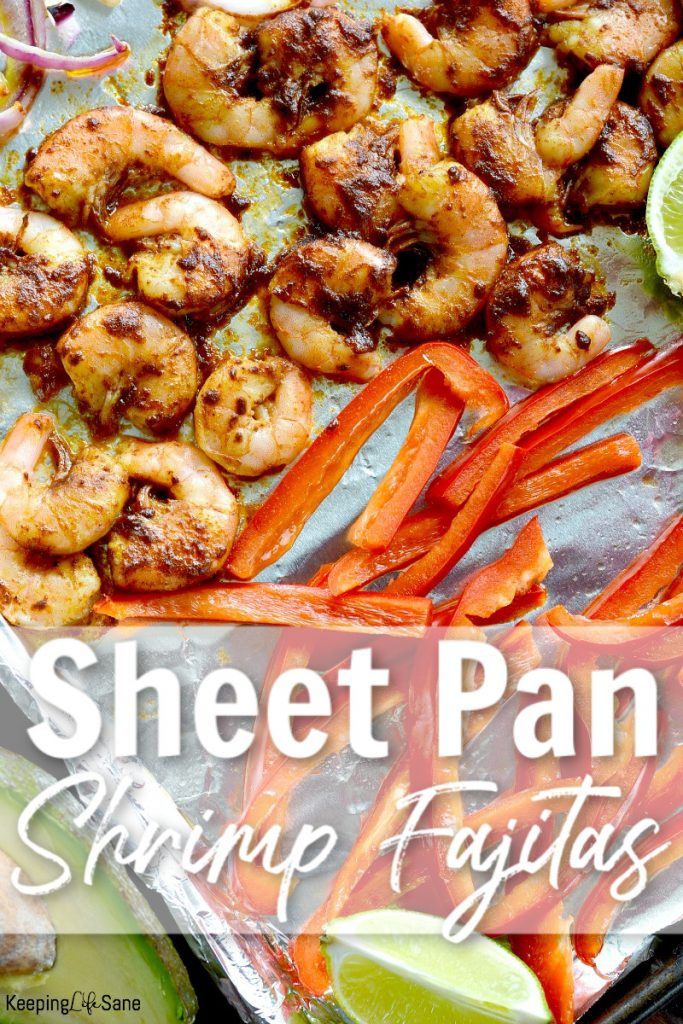 view of cooked shrimp, red peppers and lime on foil line baking sheet