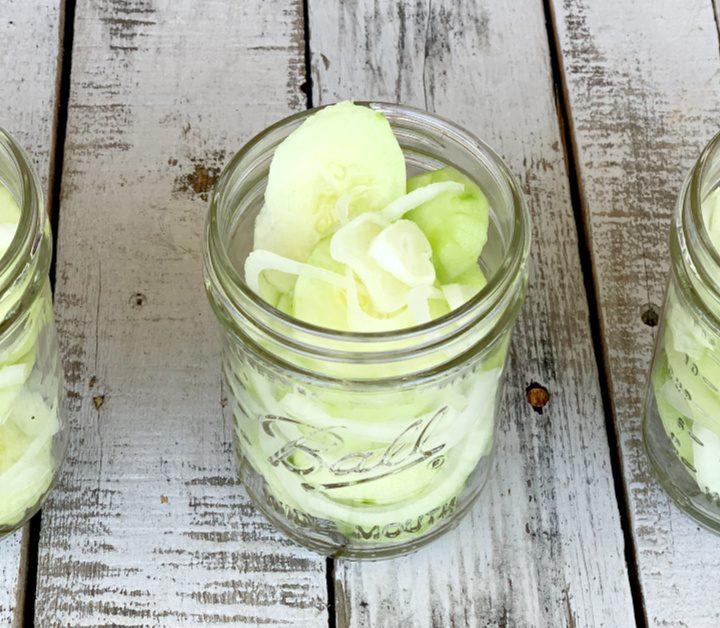 three jars of cucumbers and onions