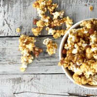 bowl of peanut caramel popcorn spilling over