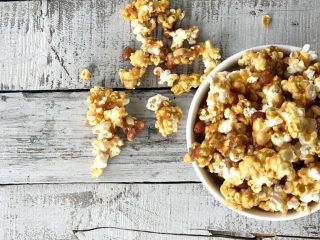 bowl of peanut caramel popcorn spilling over