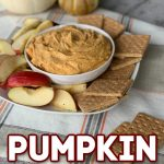 Pumpkin pie dip in bowl on plage with apple slices and graham crackers