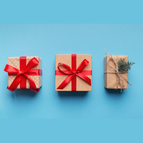 3 christmas gifts on a blue background