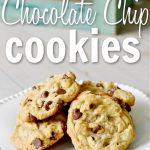 white plate with stach of chocolate chip cookies