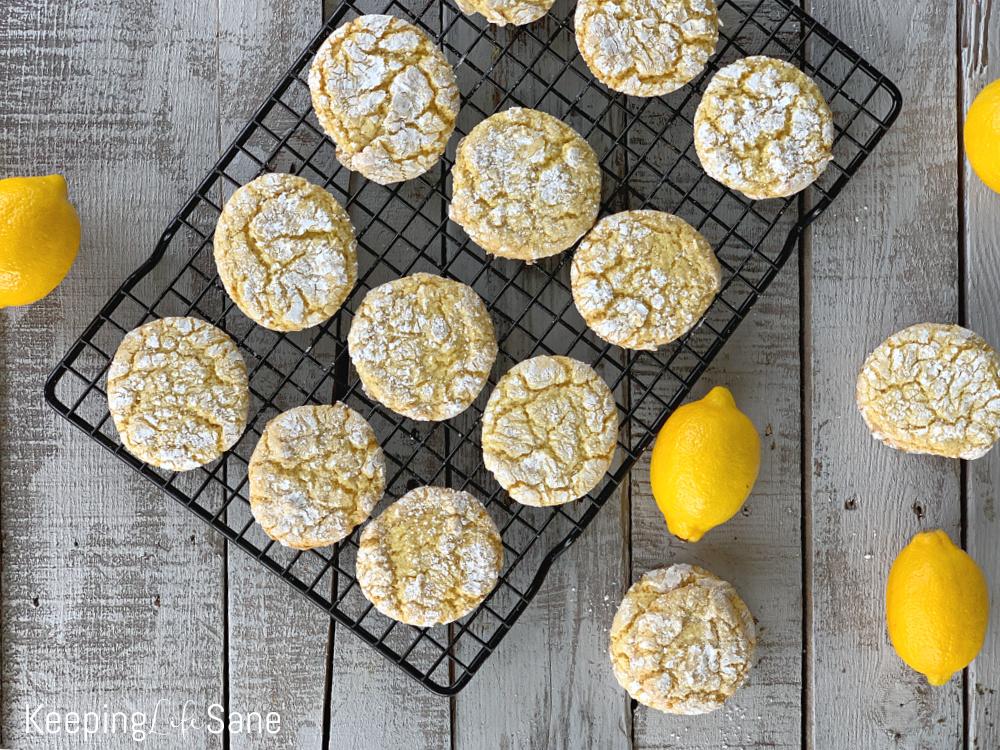 lemon cookies on black wire rack with overhead view