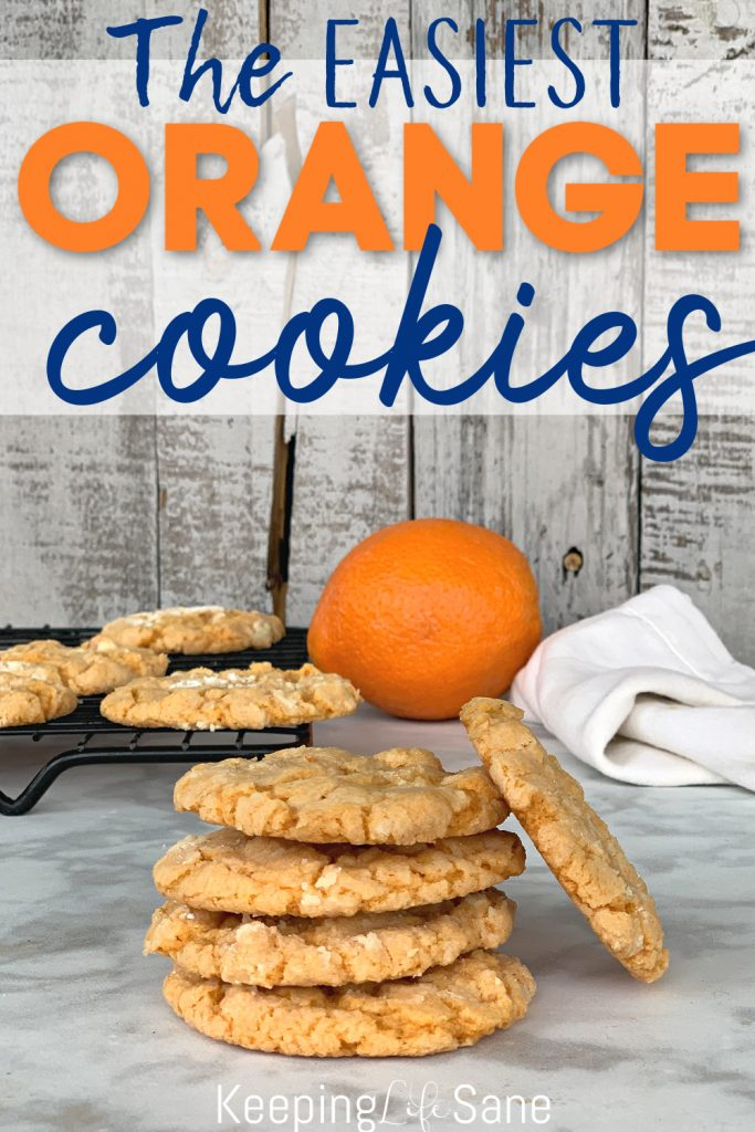 stack of orange cookies with one leaning on the stack