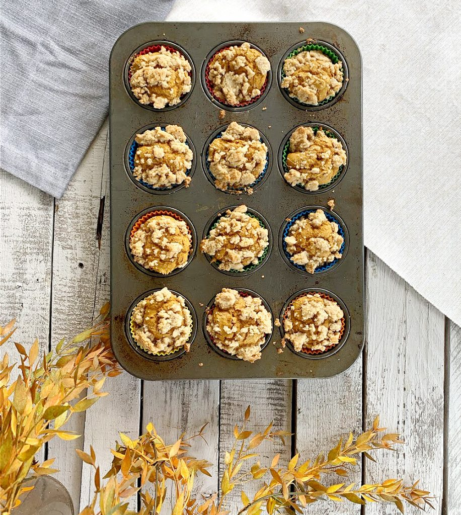 overhead view of muffin tin with 12 pumpkin muffins
