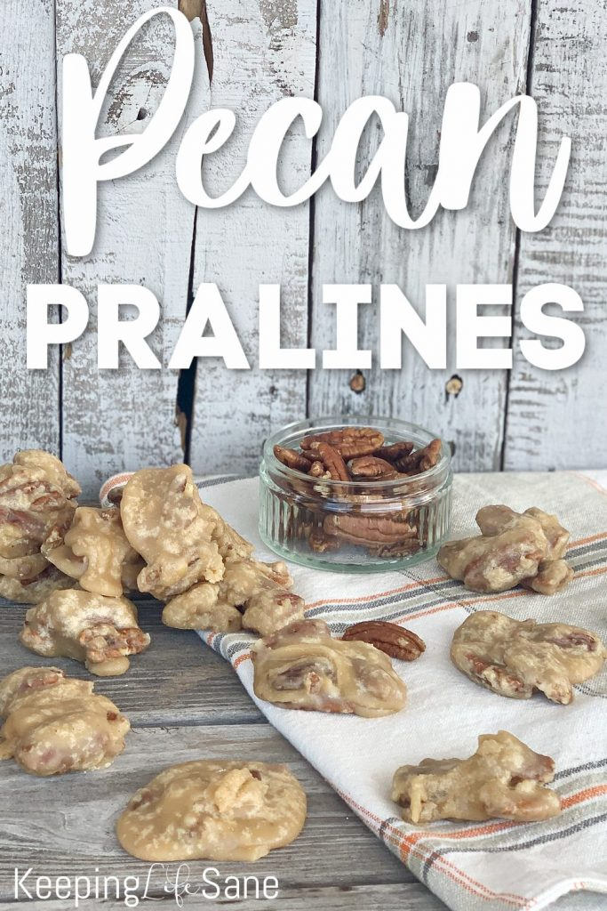 praline chews and small bowl of pecans on table