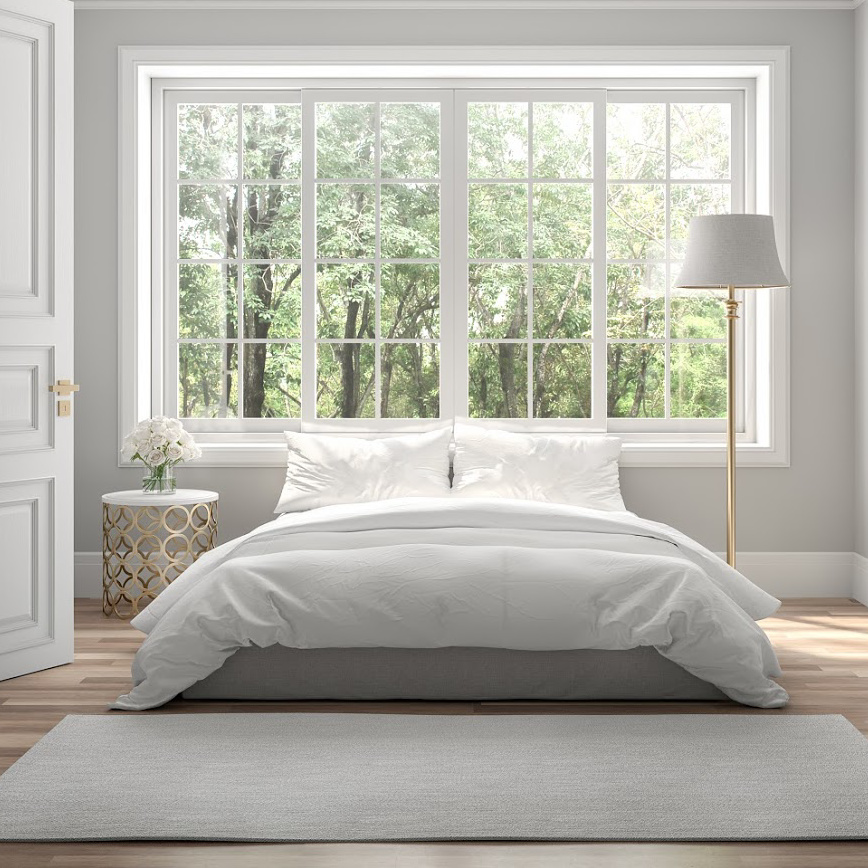 White bed with big window in background