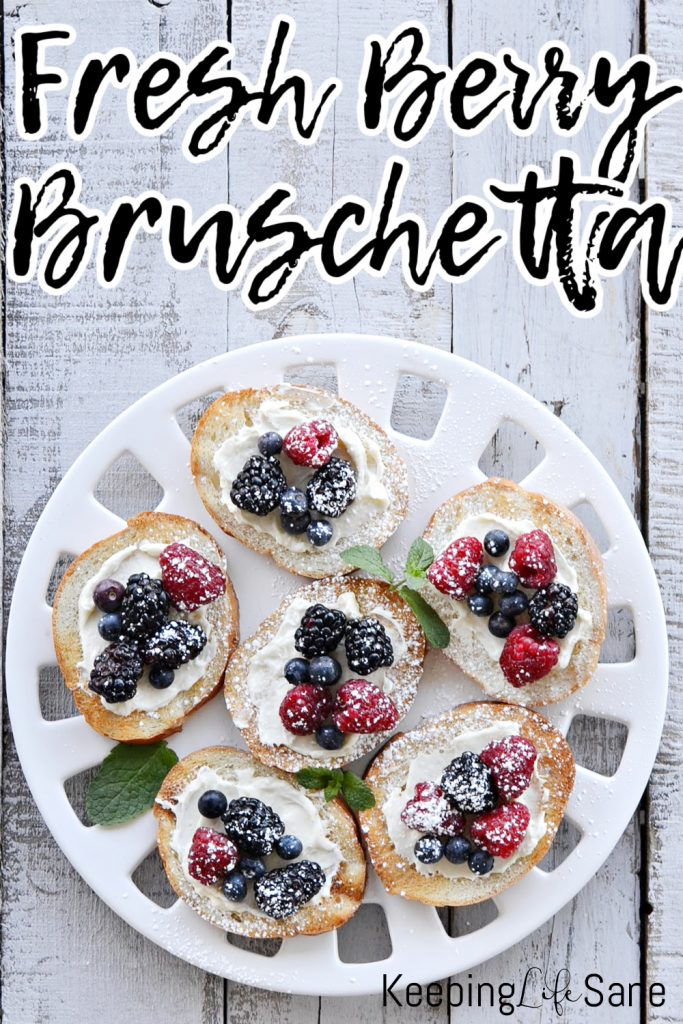 overhead view of white platter with bruschetta with berries on it