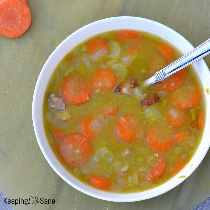 overhead view of split pea soup that's green with round carrots