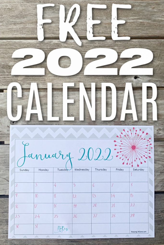 January 2022 Calendar printed out and placed on wooden table